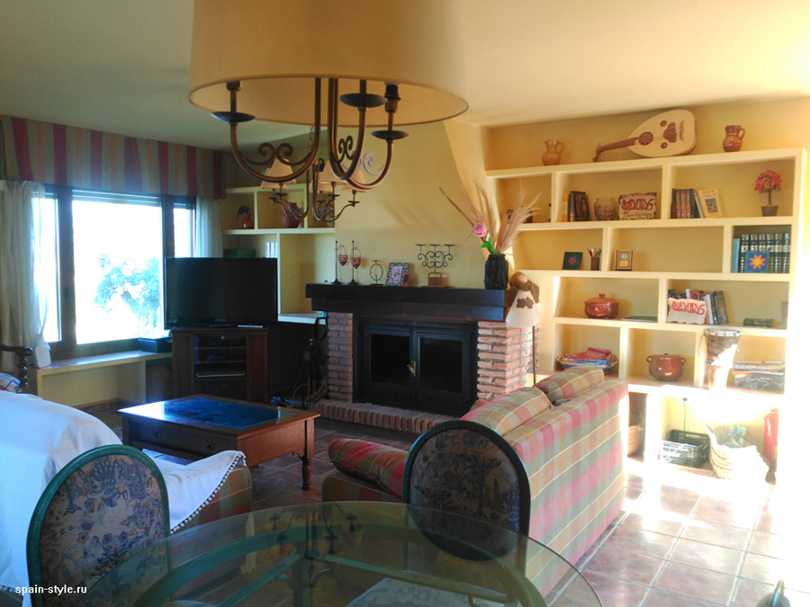 Living room with fireplace, Country house in Granada with a tourist accommodation business