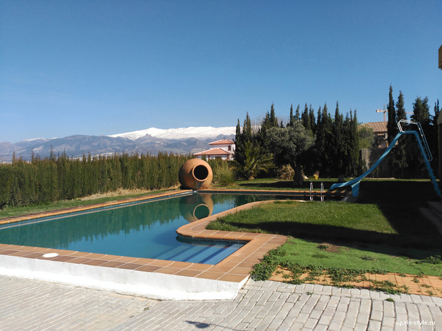 View of the pool and mountains,,  Country house in Granada with a tourist accommodation business