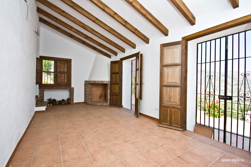 Country  house  with pool for sale in Torrox,  Living room with  a fireplace