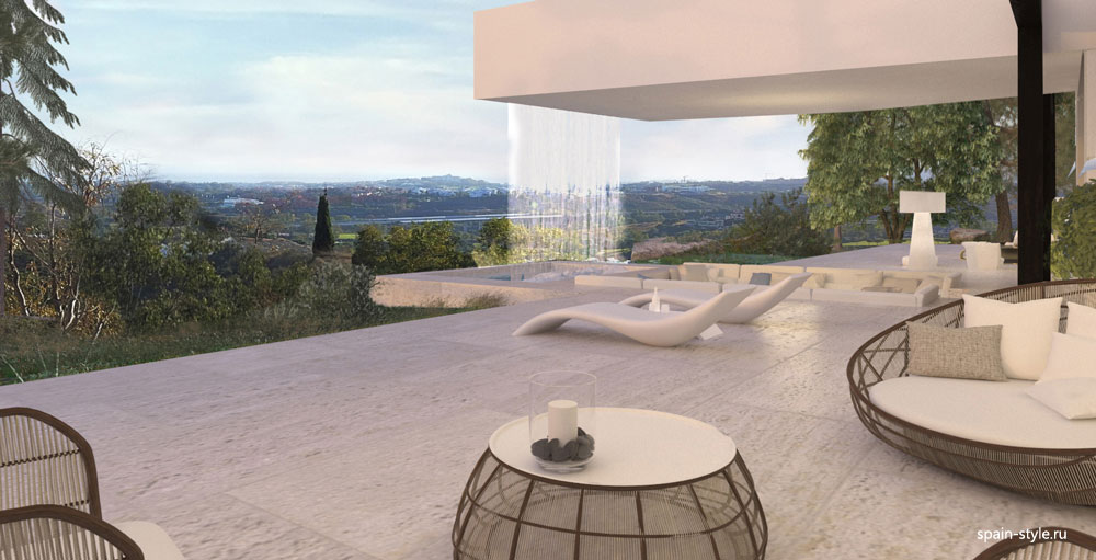 New villa in Benahavís with mountain views, Terrace with falling water from the pool