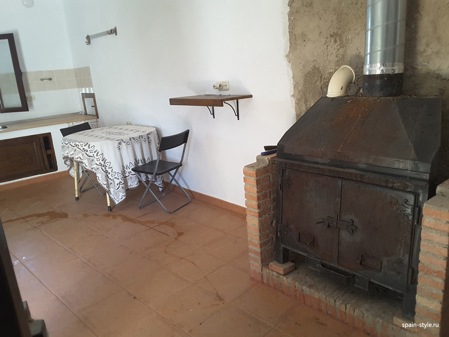 Kitchen and fireplace,  Country house with  7 ha land in the Sierra Nevada National Park